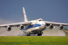 A Volga-Dnepr An-124-100 taking off from a wet airstrip. (Volga-Dnepr)