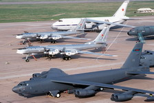 Two Tupolev Tu-95 'Bear' bombers, centre, and an A-124 transport aircraft of the Russian military, background, beside a Boeing B-52H Stratofortress of the 62nd Bombardment Squadron at Barksdale Air Force Base, Louisiana, United States on May 1 1992. (DoD photo by Technical Sergeant Fernando Serna)