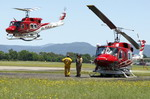 Two Australian Rural Fire Service (RSF) Bell 212 helicopters at RAAF Richmond during a training exercise on 11 December 2010. (Australian MoD/LAC David Said)