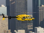 A Bell 407 in flight over the city. (Bell)
