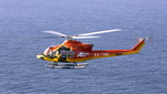 A Bell 412 in flight. Note the flotation gear on the skids. (Bell)