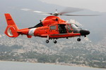 A US Coast Guard HH-60 Dolphin flies past Port-au-Prince, Haiti, during relief operations on 26 January 2010. (USCG/Petty Officer 1st Class David Mosley)