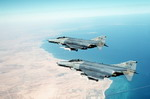 Two F-4Gs from the US Air Force's 35th Tactical Fighter Wing over Bahrain during Operation Desert Shield. (USAF/MSgt Bill Thompson)