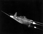 A Bell P-39 Airacobra firing all weapons at night. (USAF)